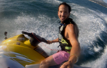 Pension scammer riding a jet ski